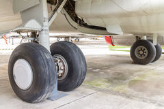 Rear landing gear and engine passenger plane on the ground Royalty Free Stock Images