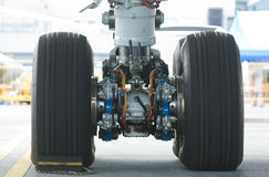 Rear landing gear of wide-body airplane Stock Photos