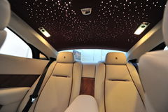 Rear leather seats with star ceiling of the Rolls Royce Wraith on display during Singapore Yacht Show at One Degree 15 Marina Club. SINGAPORE - APRIL 12: Rear Royalty Free Stock Images