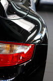 Rear light. And car wing of black sports car Stock Image