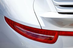 Rear light. Detail on the rear light of a white car Royalty Free Stock Photo