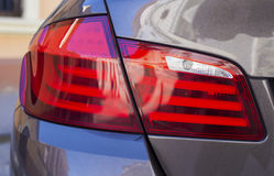 Rear light. Luxury car rear light closeup Stock Images