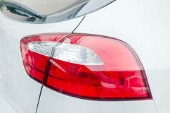 Rear light of a modern car. Red rear light of a modern white car Royalty Free Stock Image