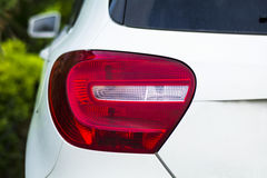 Rear light of a modern car. Rear light of a modern white car Royalty Free Stock Photography