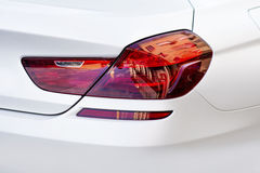 Rear light of a modern white car. Rear red light of a modern white car royalty free illustration