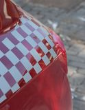Rear light of a red sports car with a checkered flag decoration stock images