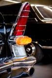 Rear lights of black retro car close-up Royalty Free Stock Photos