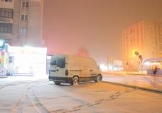 Rear lights of car on backyard in dark foggy winter night Stock Images