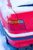 Rear lights on a red car in the snow. Royalty Free Stock Photo