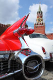 Rear lights in rocket form of Cadillac. MOSCOW, RUSSIA - APRIL 24: Rear lights in rocket form of Cadillac on Kremlin background on Vintage car rally The opening Stock Photography