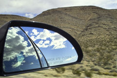 Rear mirror. A rear mirror of a car in the mohave desert Royalty Free Stock Photography