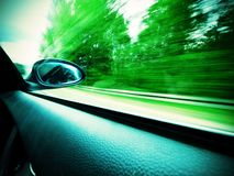 Rear mirror. Car and rear view mirror on the road Royalty Free Stock Photos