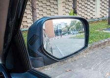 Rear mirror side view of the car. Close up rear mirror side view of the car Stock Image