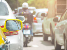 Rear mirror of taxi while jammed in traffic on road Stock Image