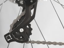 Rear mountain bike speed switch. Small star of the rear mountain bike speed switch on a gray background Royalty Free Stock Photo
