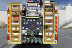 Fire truck rear panel on view. The rear od a fire engine with the various dials and equipment controls Royalty Free Stock Photos