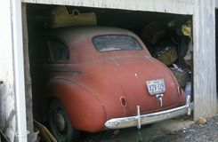 The rear of an old American car sticking out of a garage in Virginia Royalty Free Stock Images