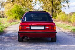The rear of the old, red, German car.  royalty free stock photo
