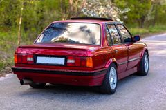 The rear of the old, red, German car.  stock photography