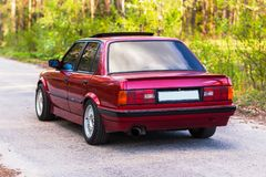 The rear of the old, red, German car.  stock photos