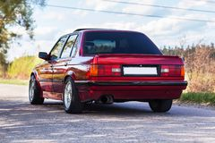 The rear of the old, red, German car.  stock photo