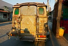 Rear of an old rusty jeepney type of delivery truck royalty free stock photos