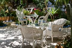 Rear open courtyard of a Greek house with white wooden furniture. Stock Photography