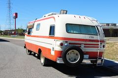 Rear of Orange and White Travco Elite Motorhome. Stock Images