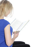 Rear view of a woman reading a book Royalty Free Stock Photography