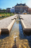 The rear of the palace Het Loo with a decorative fountain in the Royalty Free Stock Images