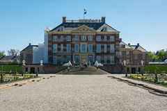 The rear of the palace Het Loo with a decorative fountain in the Stock Image