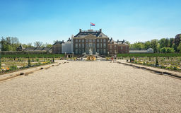 The rear of the palace Het Loo with a decorative fountain in the garden Royalty Free Stock Photo