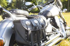 Rear part of motorcycle. Black leather bag. Royalty Free Stock Image