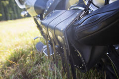 Rear part of motorcycle. Black leather bag. Stock Images