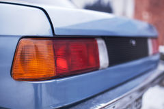 The rear part of rearlights old blue car Royalty Free Stock Images