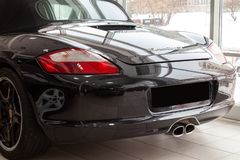 Rear quarter view of the 2006 sport porsche boxster s sedan prepared for sale and exhibited in the showroom with a polished shiny stock image