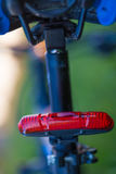 Rear red bicycle lamp Royalty Free Stock Photos