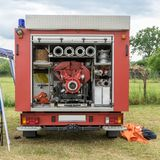 Rear of a fire truck. Rear of a red fire engine with hoses and pump Stock Photos