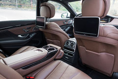 Rear seats in luxury car. The rear seats in luxury car with multimedia system Royalty Free Stock Photography
