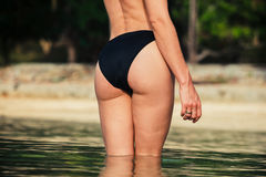 The rear of a sexy woman on tropical beach Royalty Free Stock Photos