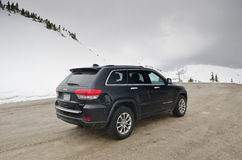 Rear shot of black Jeep Gran Cherokee around snow Stock Image