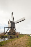 Rear and side of a Dutch wooden hollow post mill Stock Photography