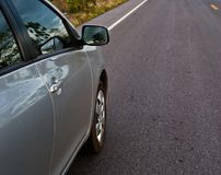 Rear side perspective view of car on road countryside. Rear side perspective car on road countryside Royalty Free Stock Image