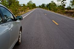Rear side perspective view of car on road countryside. Rear side perspective car on road countryside Stock Photos