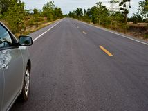 Rear side perspective view of car on road countryside. Rear side perspective car on road countryside Stock Photo