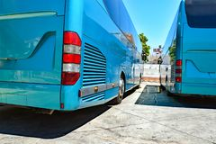Rear side of two parked coaches royalty free stock photos