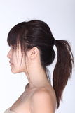 Rear Side View of asian woman black hair, studio lighting white. Background stock images