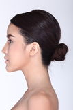 Rear Side View of asian woman black hair, studio lighting white royalty free stock photography