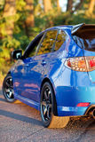 Rear side view of blue sport car.  Royalty Free Stock Image