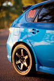 Rear side view of blue sport car.  Stock Photo